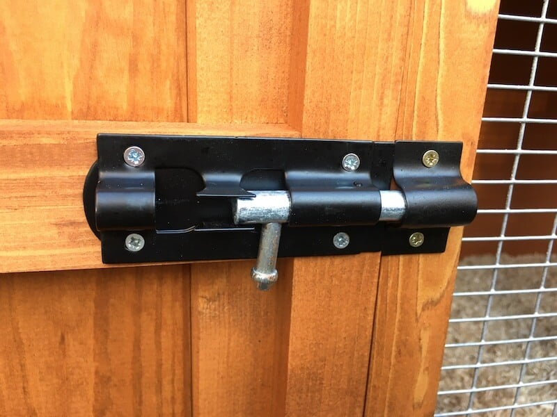 latch on an outdoor wooden guinea pig hutch